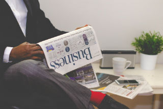 Man reading newspaper.jpg